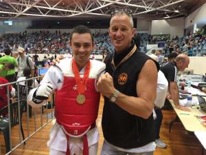 Jung Moo Taekwondo Student wins gold at tournament, 2016